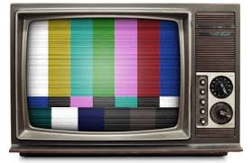 Photo of vintage TV showing rainbow colored vertical stripes across screen