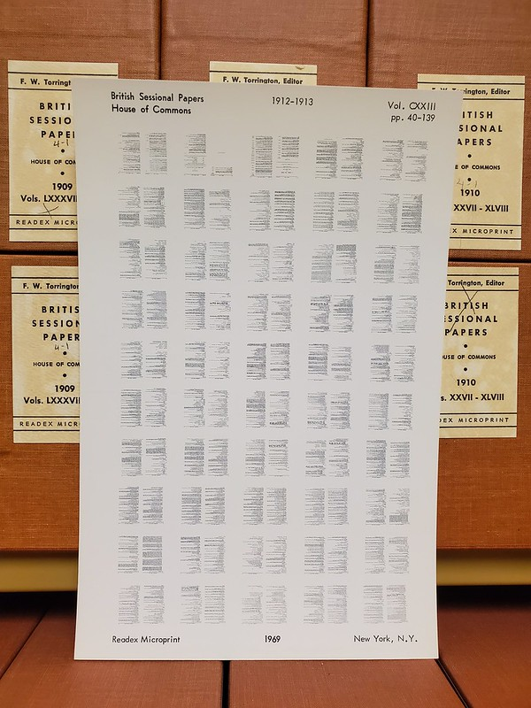 image of microprint sheet leaning up against some boxes