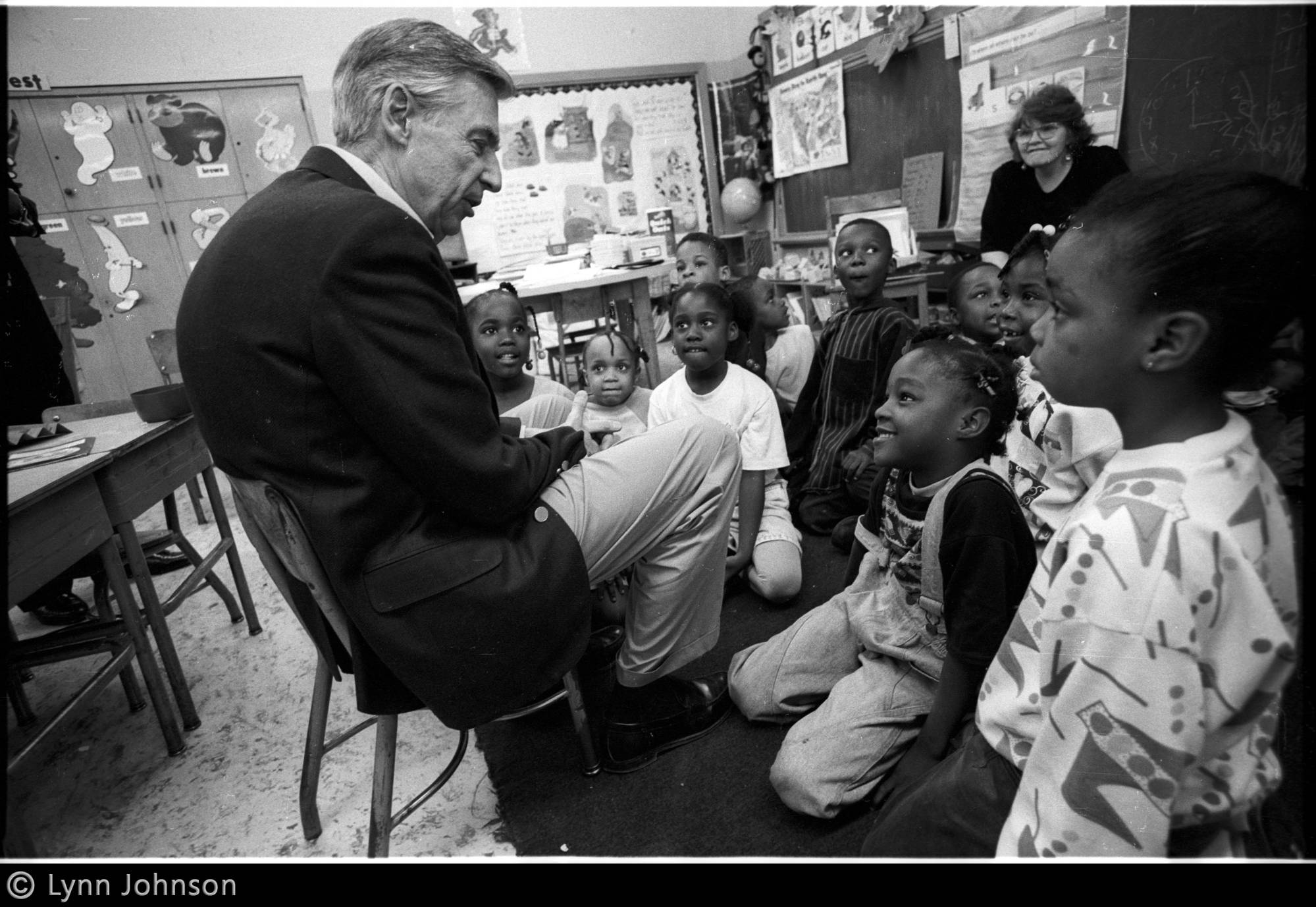 Lynn Johnson photograph of Fred Rogers speaking with a group of school children