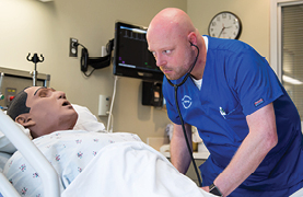 Wake Tech student works in a simulation lab.