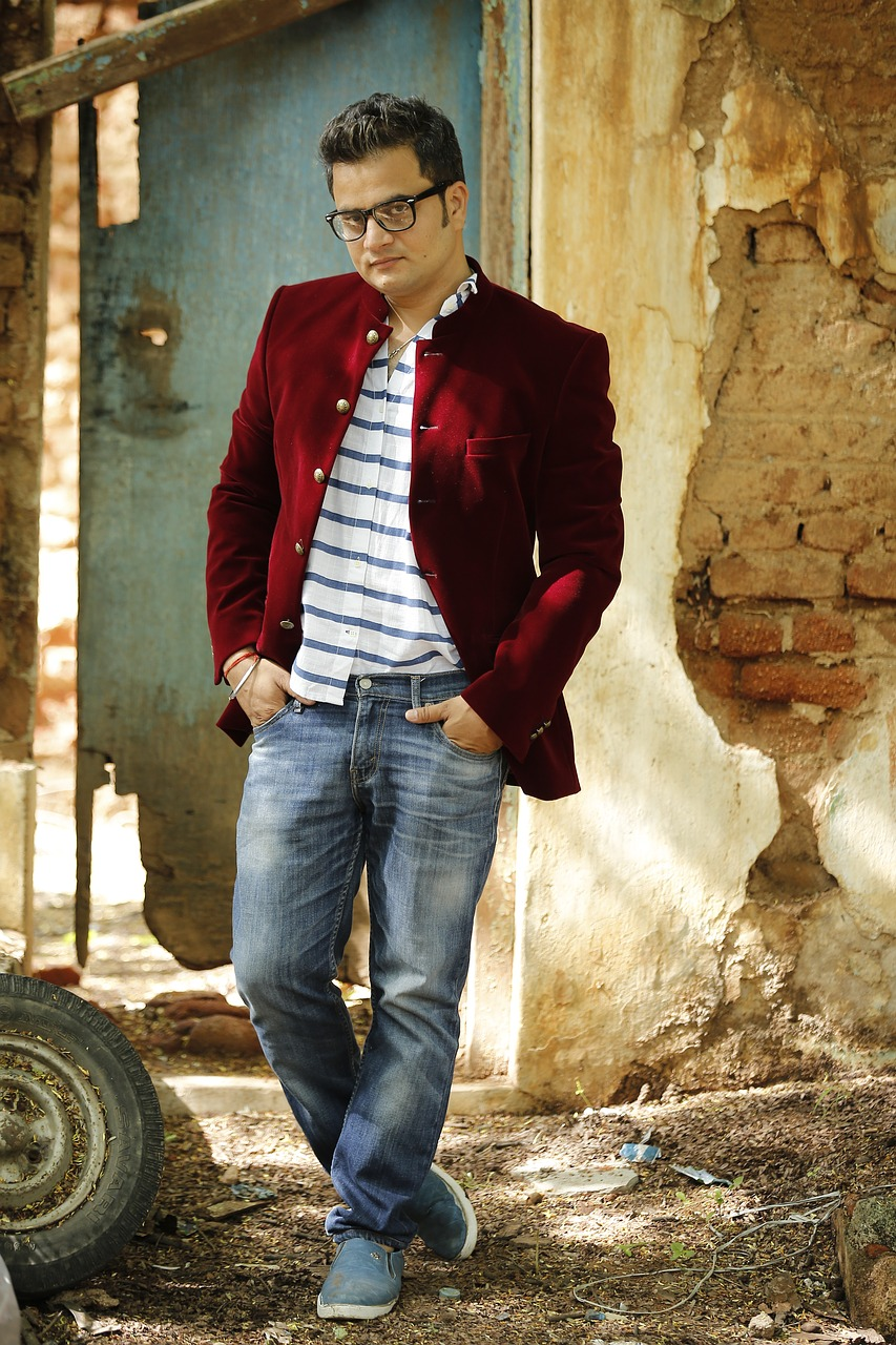 Male model showing jeans and red jacket