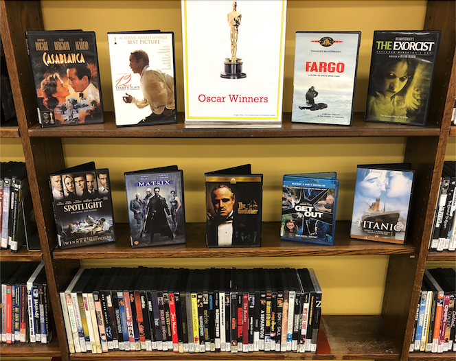 The library's April 2021 DVD display, featuring past Oscar winners.