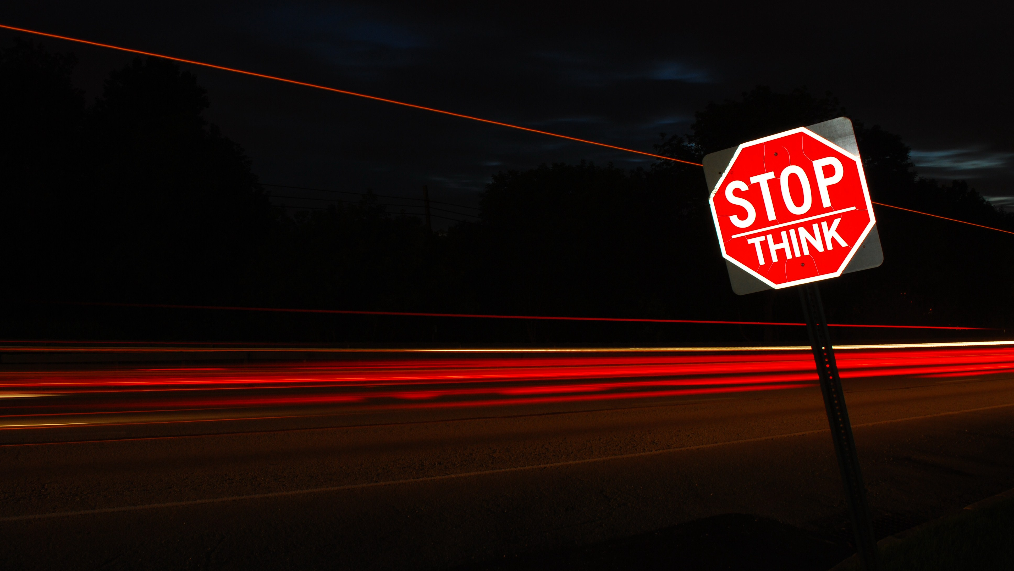 Image of Stop sign. Text reads stop. think.