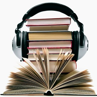 pair of headphones on stack of books