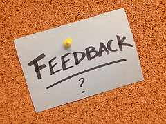 bulletin board with feedback note push pinned in