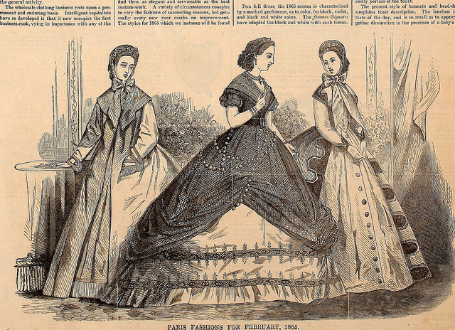 Historic image of three women in large dresses