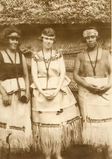 Margaret Mead standing between two Samoan girls