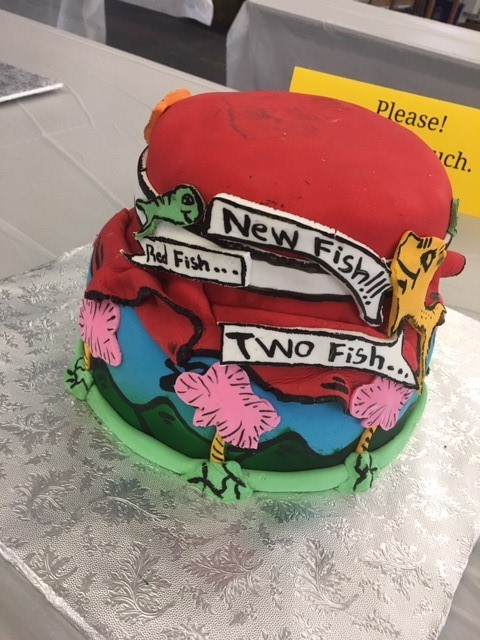 Two-tier cake decorated with text and images