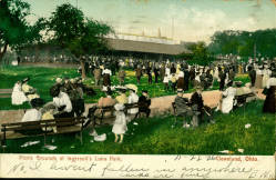 Picnic Grounds at Ingersoll's Luna Park, Cleveland, Ohio. Bowdin Post Card Collection. Women in big frilly hats and long dresses siting on benches in a park, about 1906