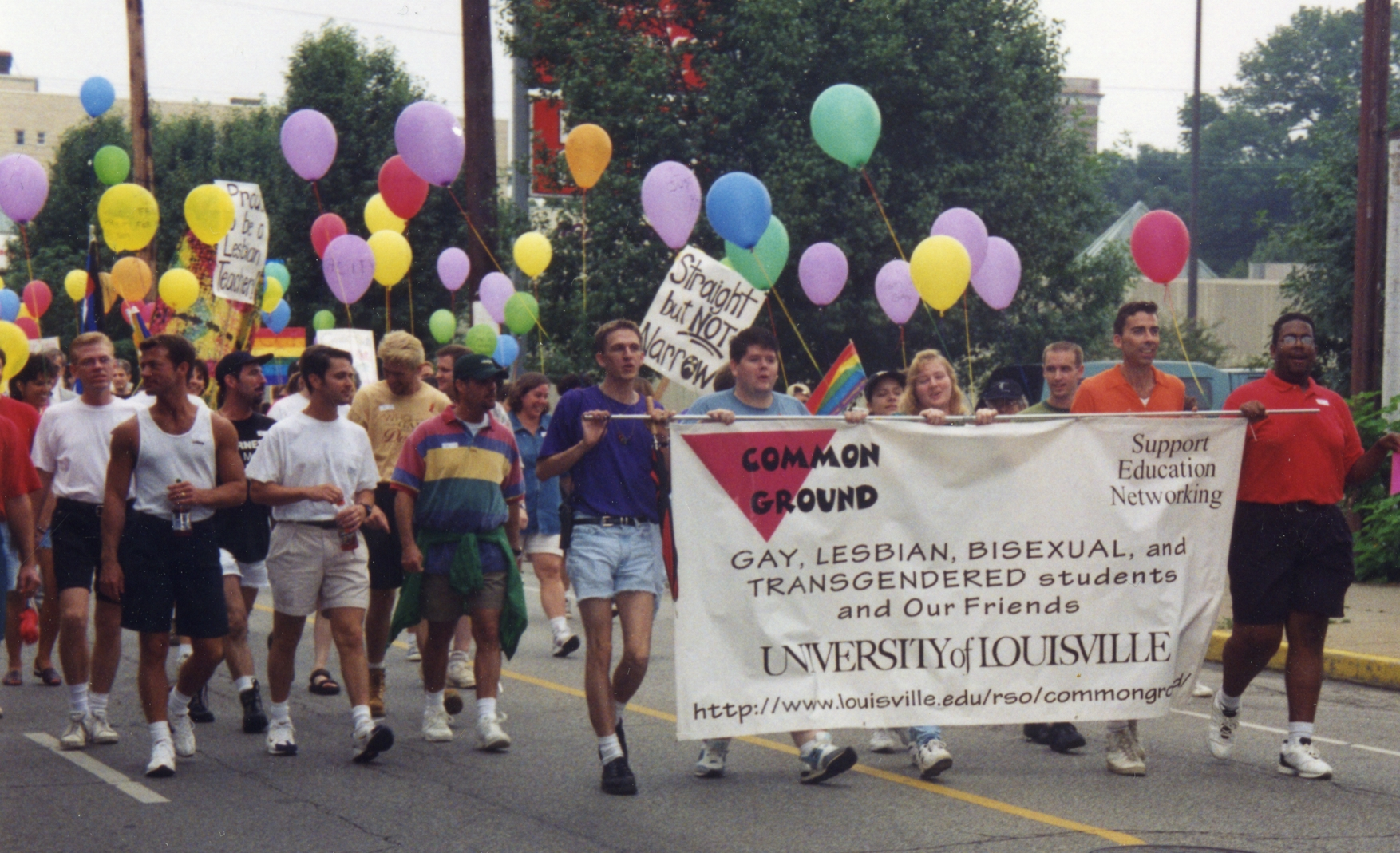 Image of University of Louisville student group Common Ground marching in a parade. 1997.