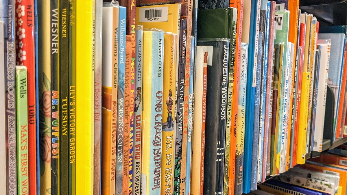 Children's books organized on a shelf