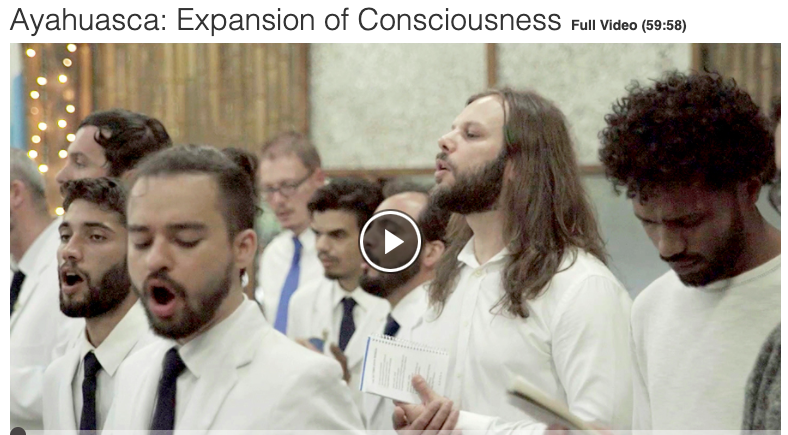 Still image showing men dressed in white, singing, from video called Ayahuasca Expansion of Consciousness available from Films on Demand database
