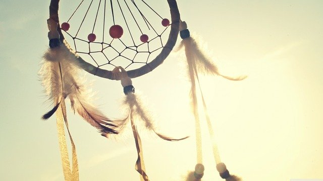 native american dreamcatcher with sky in background