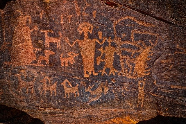 petroglyph showing human figures and animals