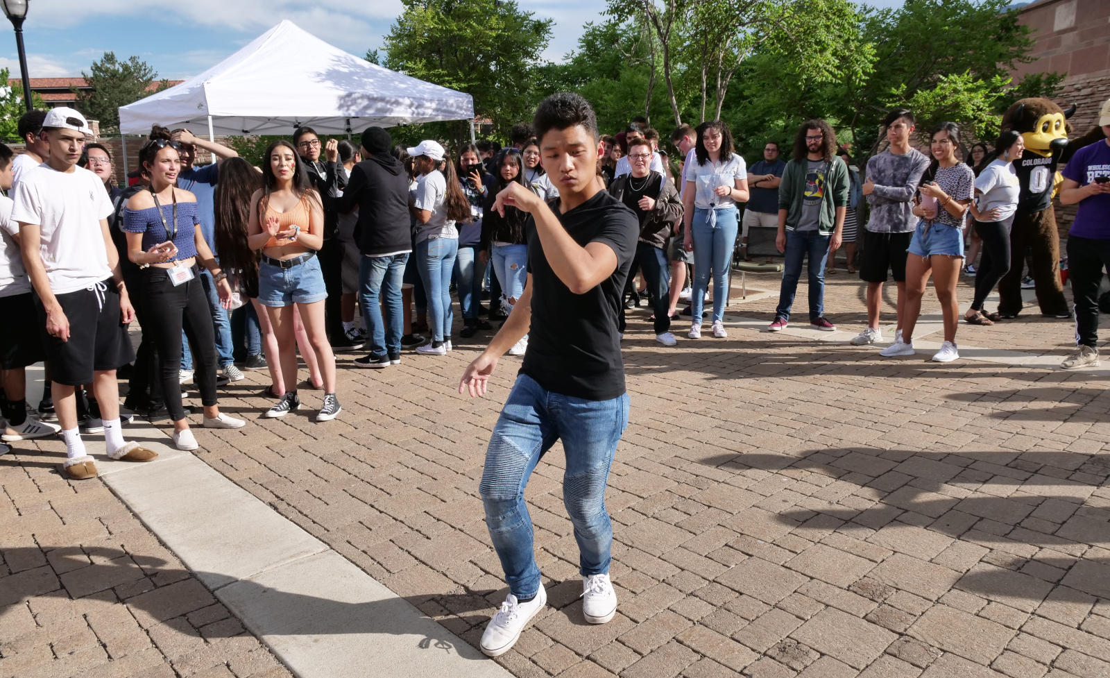A student dances while others look on at the Ice Cream Social