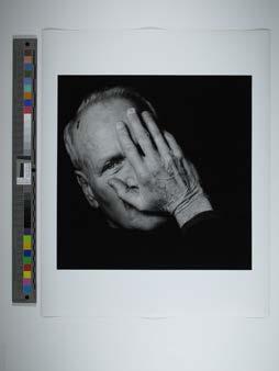 Paul Newman covering face