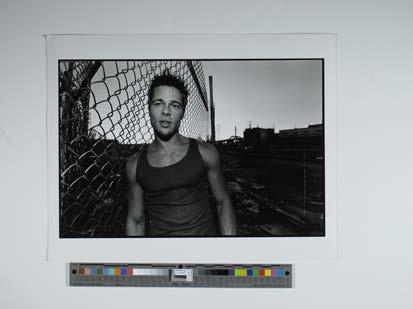 Brad Pitt 1998 by fence