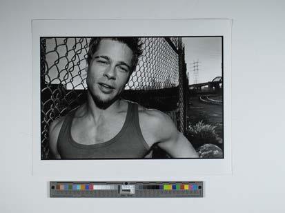 Brad Pitt 1998 by fence closer view