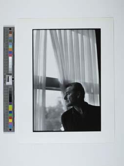 Errol Flynn, Mexico 1958 by a window
