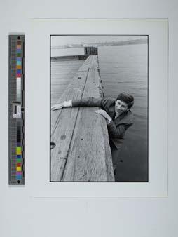 Roman Polanski hanging off pier