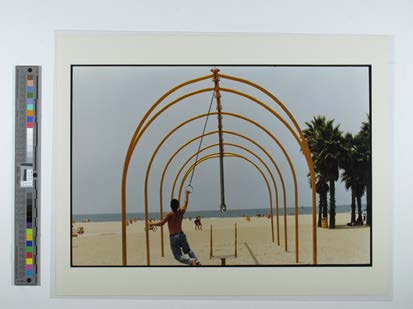 Oskar Lopez on flying rings, Venice Beach, CA