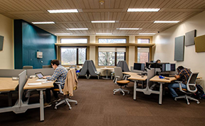 Students using spaces and computers in the Graduate Commons