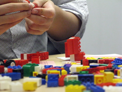 Creative Commons image of hands manipulating colorful Legos.