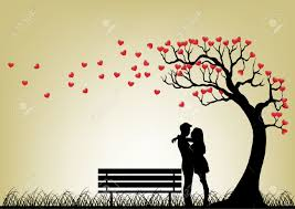 silhouette of a couple hugging underneath a tree