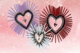 threes different sized fuzzy hearts aganist a pink background