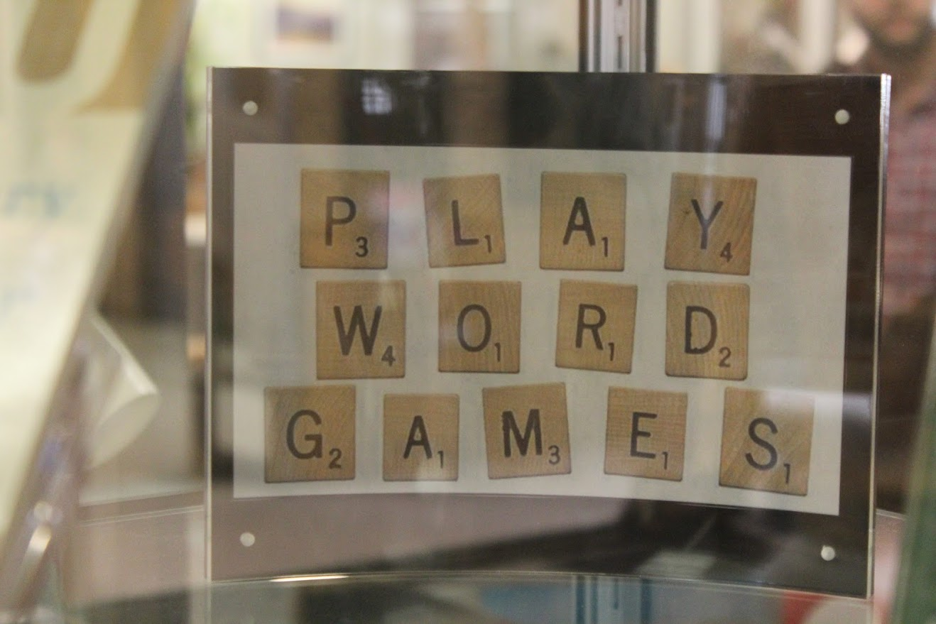 Play Word Games spelled out in scrabble letters
