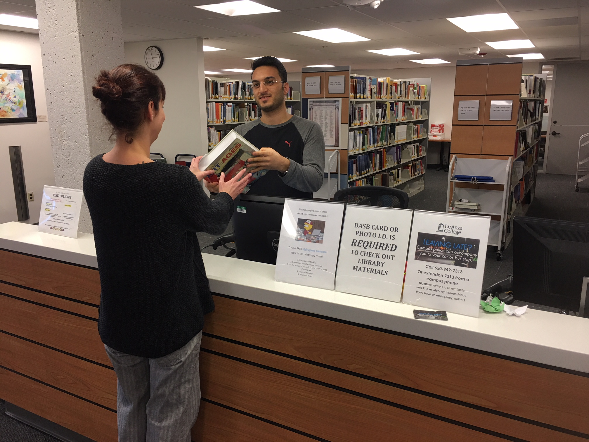 photo of student checking out a book