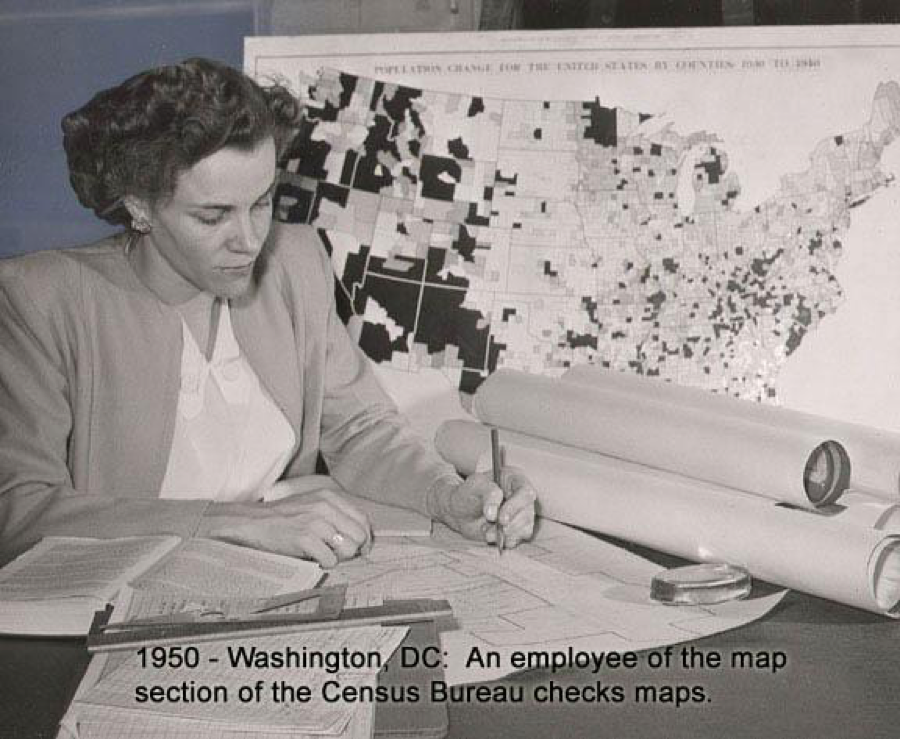An employee of the Census Bureau's map section reviews maps