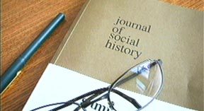photo of pen, journal, glasses