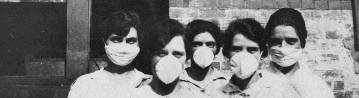 women in surgical masks-influenza