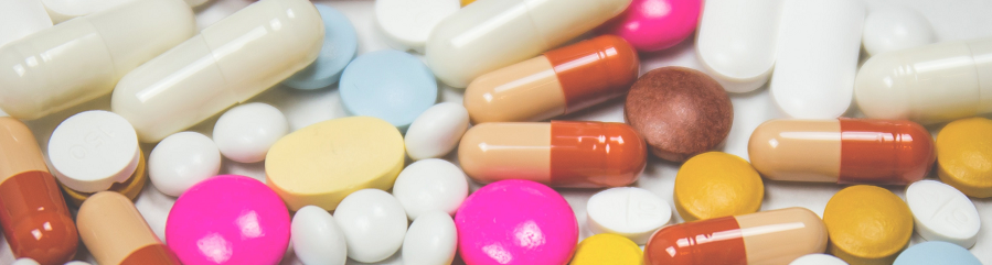 A variety of brightly colored pills and tablets.