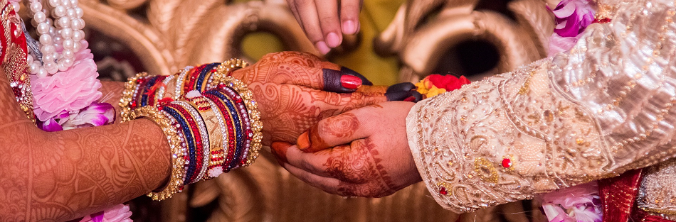 Indian wedding: close up of the couple's hands.