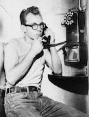 Man talking on pay phone