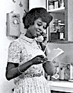 Woman talking on telephone, 1965 magazine ad