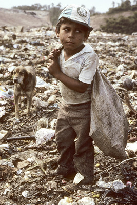Seven-year-old picking garbage in a dump near Sao Paulo. [1986]