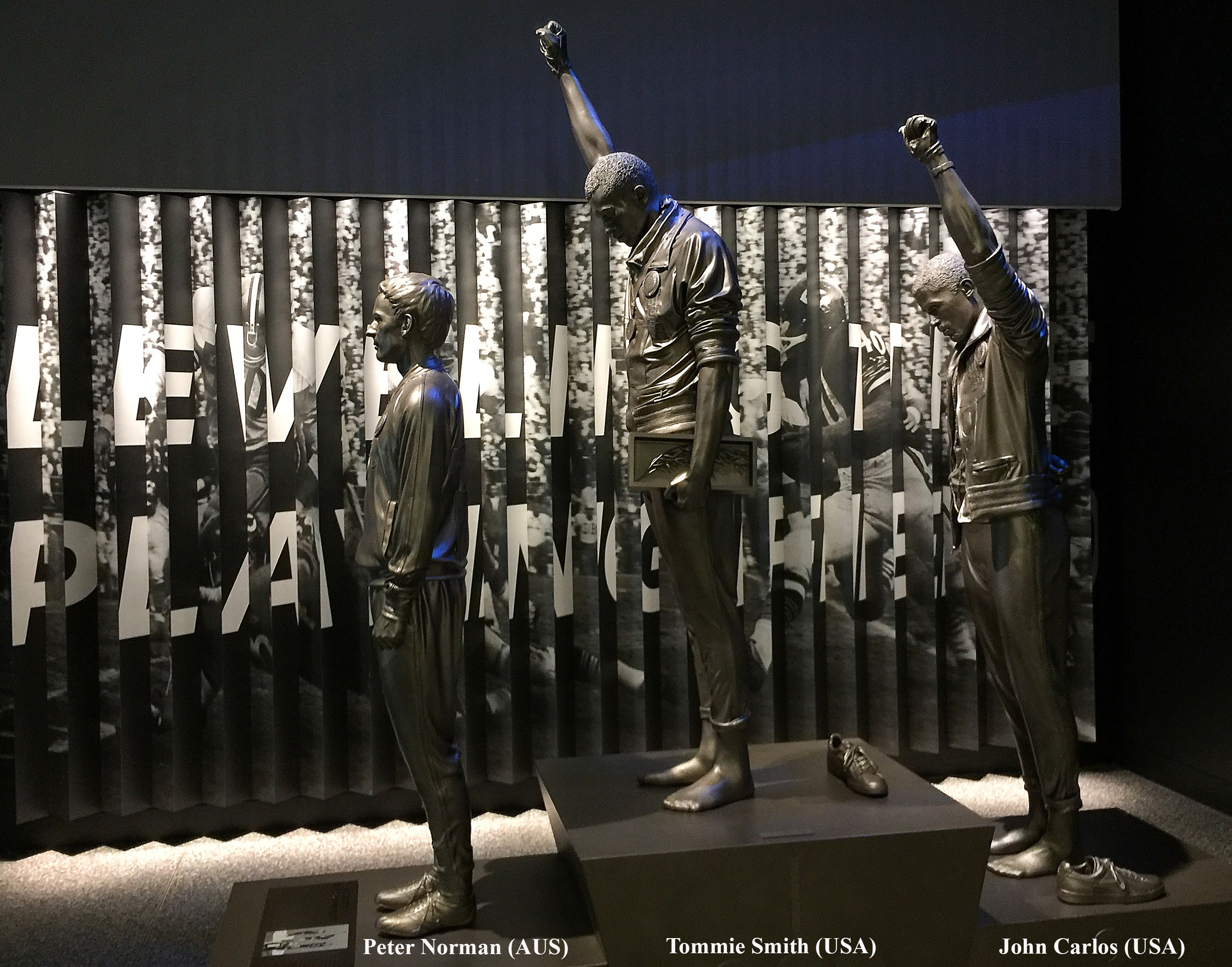 """photograph of """"The 'Black Power' Salute at the 1968 Olympic Games -- The National Museum of African American History and Culture (DC) 2017"""" by Ron Cogswell"""