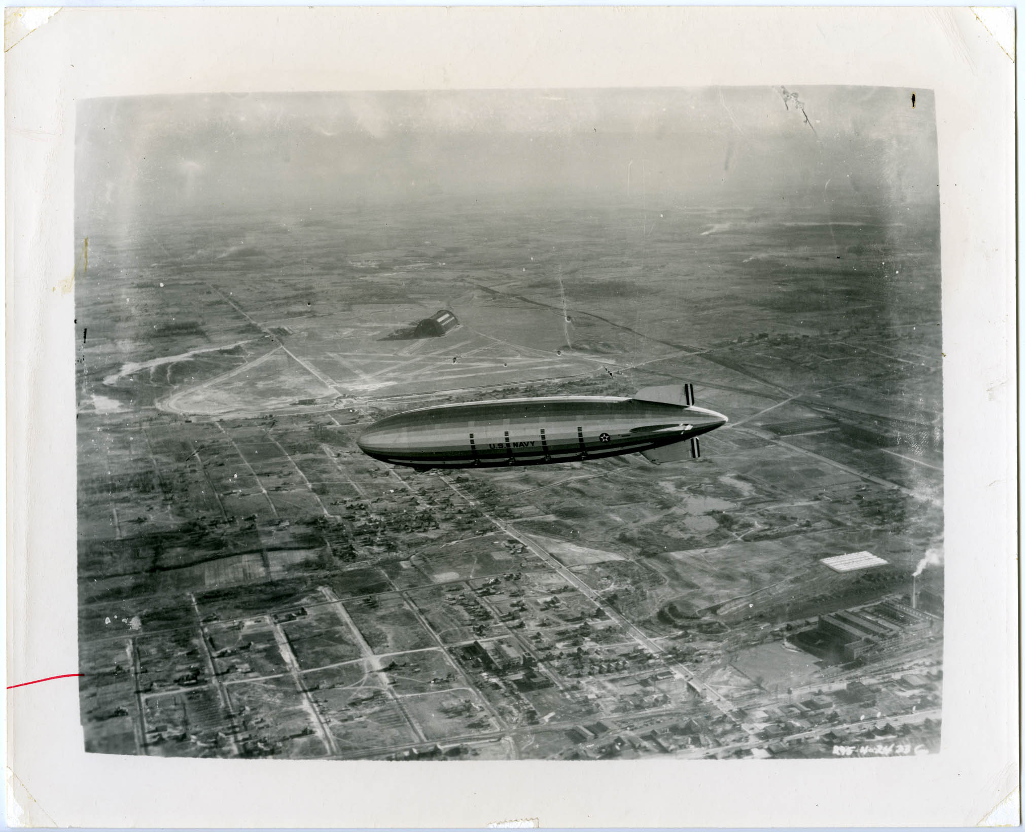 U.S.S. Macon flying above the Goodyear airship han