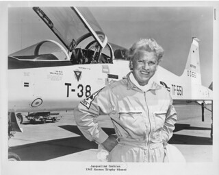 woman aviator in front of plane