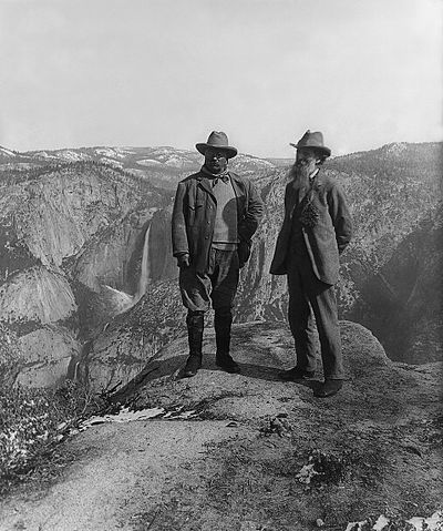 two men in front of mountains