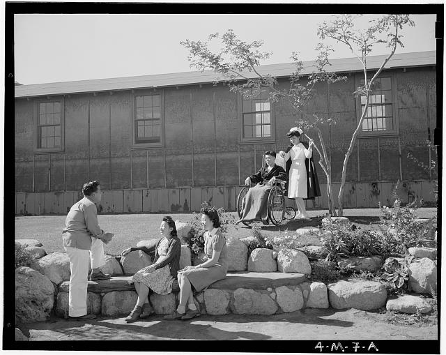 nurse and patients at internment camp