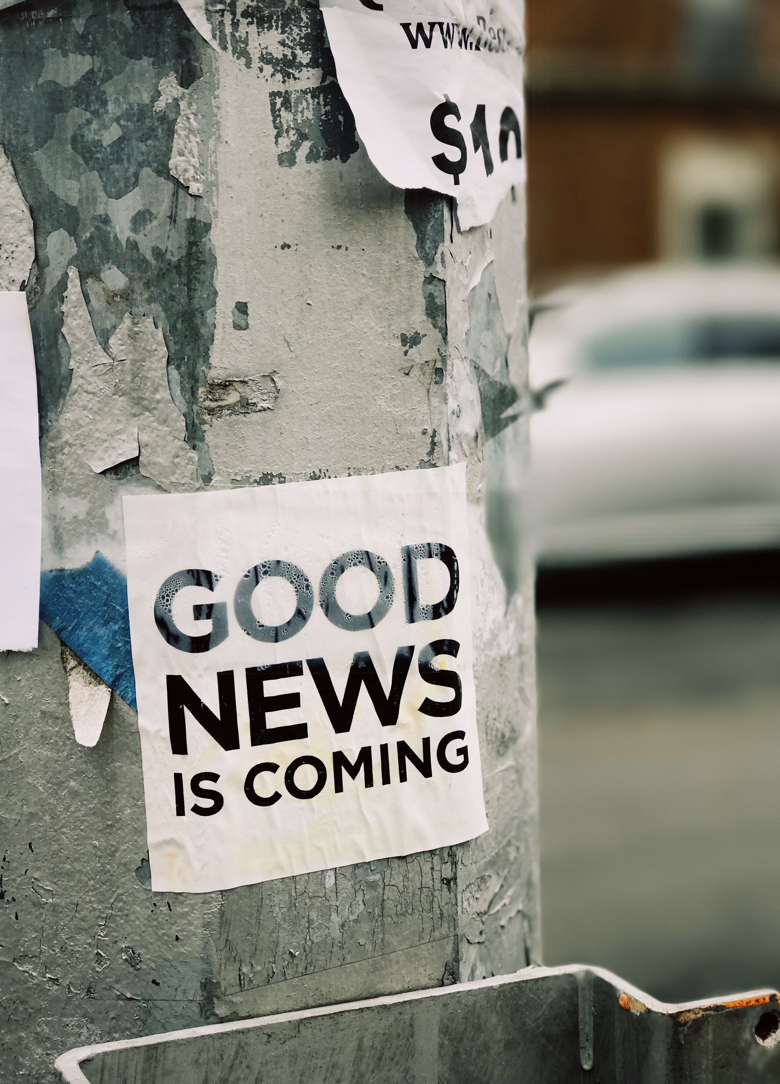 Good News is Coming! Scrap of Paper on a pole