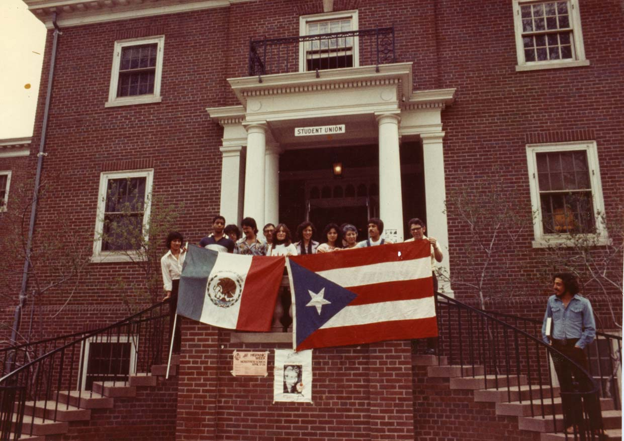 Students in front of the Student Union with flags