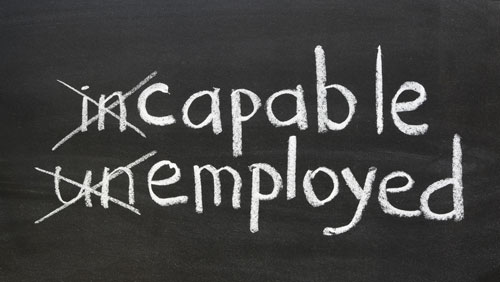 chalkboard with the words incapable and unemployed with in and un crossed out reading capable and employed
