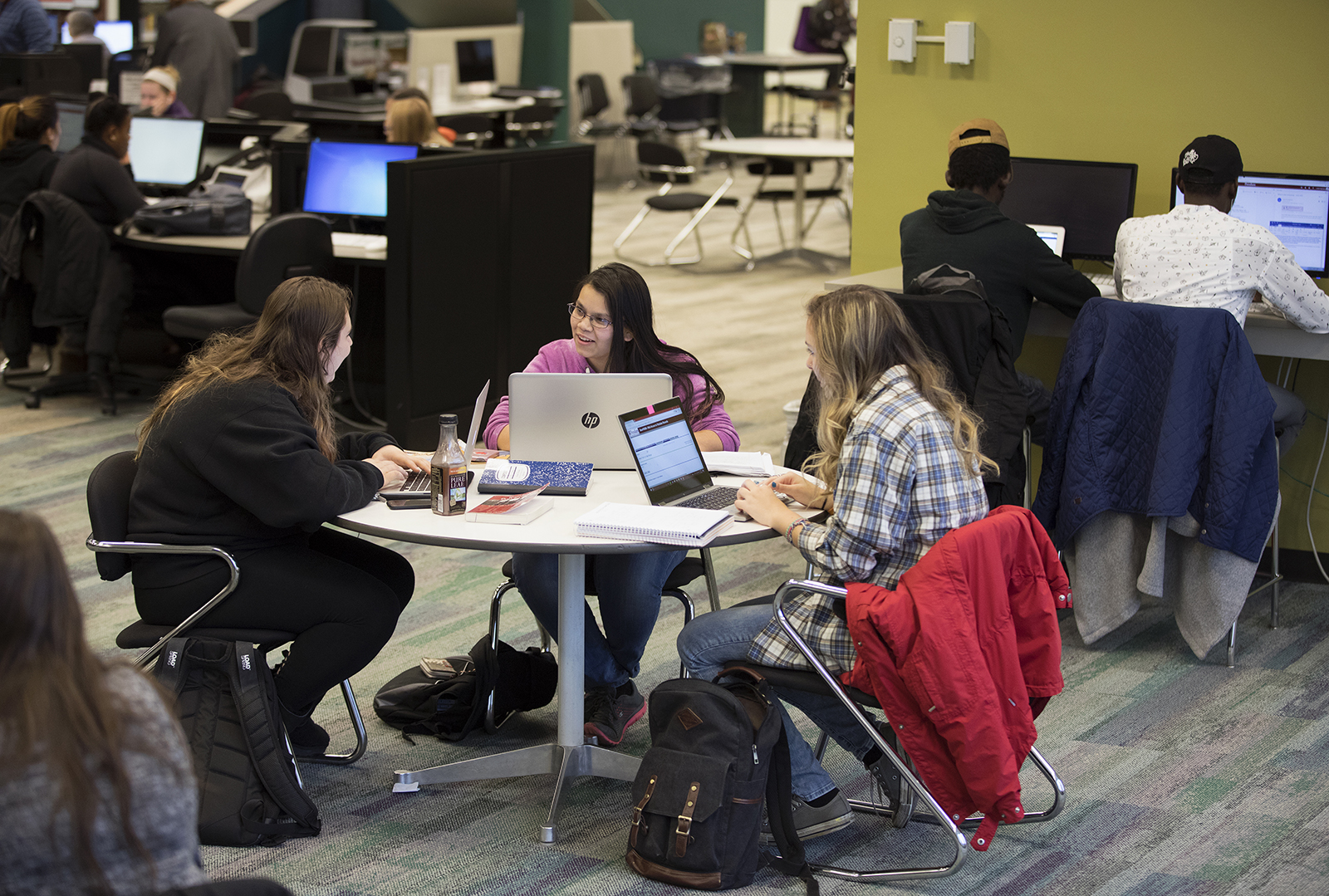 Students working in the Commons area