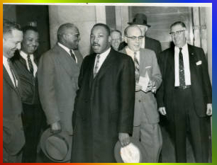 Martin Luther King Jr. emerging from a Fulton County courtroom with his father and others.