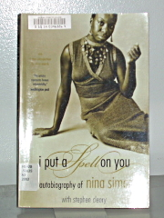 A book about Nina Simone on the shelf for the display